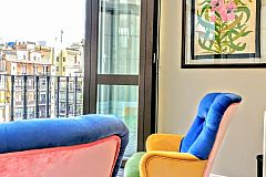the Dandi luxury apartment for rent in Barcelona also boasts a glass gallery in the master bedroom that can be opened becoming a terrace