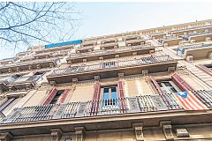 building façade of this apartment in Barcelona, located in the modernist Catalan neighbourhood of Eixample right district