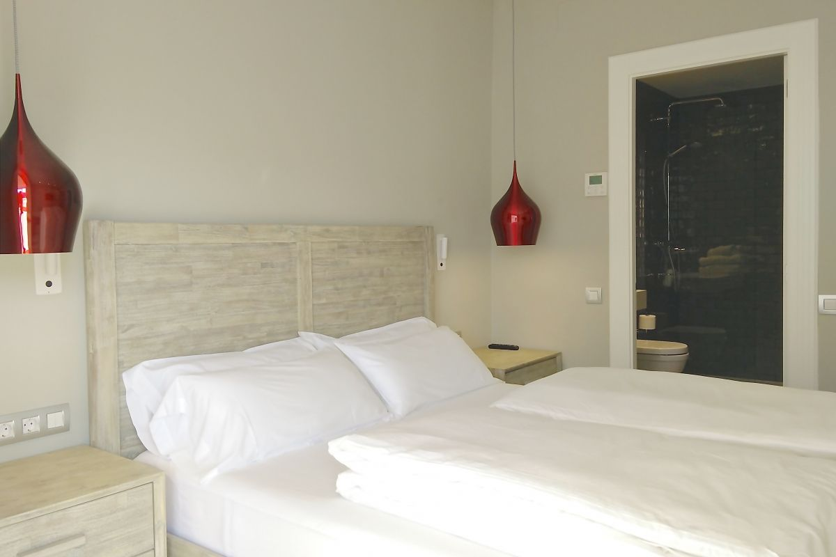 in this beautiful master bedroom at the Ferran Batik apartment you may dream about all things to do in Barcelona