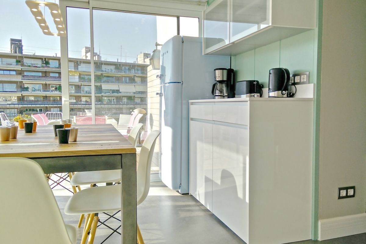 the Kitchen, a clean, fully fitted kitchen with all utensils, dishwasher and Nespresso
