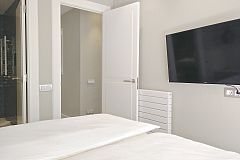 the master bedroom also boasts a flat screen TV set