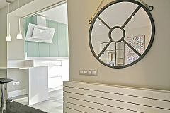 the big mirror is part of a well hand picked interior decoration in this amazing property for rent in Barcelona