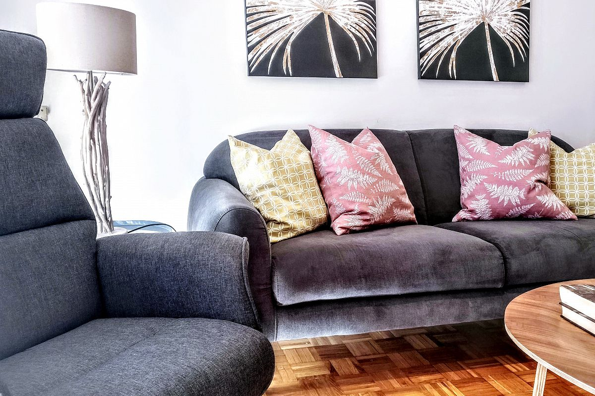 settle into the living area's lush and comfortable sofa to watch television or talk with your friends