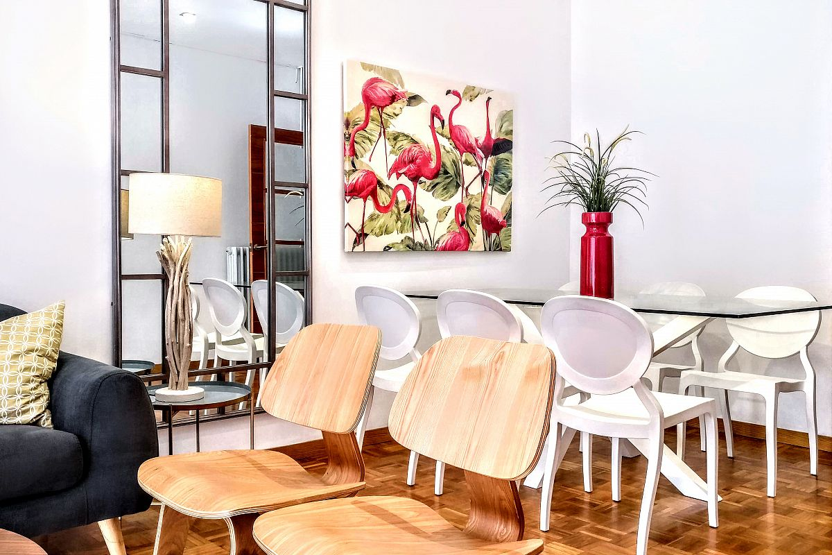 the dramatic flamingos painting is the main focal point in the sleek dining area of the Noname property with terrace in Barcelona in the Eixample area