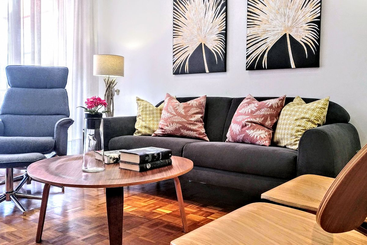 all the pieces of furniture are part of a well hand picked interior decoration in this amazing property for rent in Barcelona