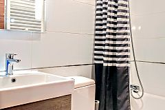 full bathroom with a modern look and heated towel rail