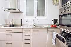 the kitchen is a clean, fully fitted kitchen with all utensils and dishwasher