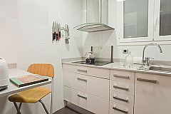 well-equipped kitchen with lots of storage space and a sweet dining corner for a quick morning coffee