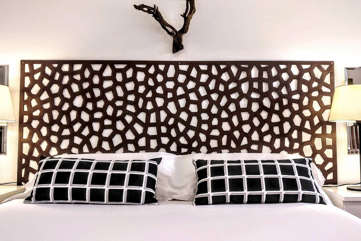 dramatic headboard detail fitting to perfection the bed cushions