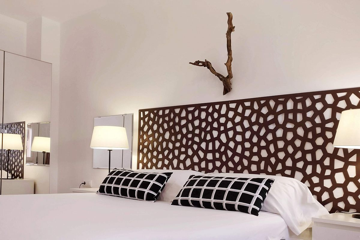 get yourself settled in the pristine white bed linen of the main bedroom of the Graden House property for rent in Barcelona