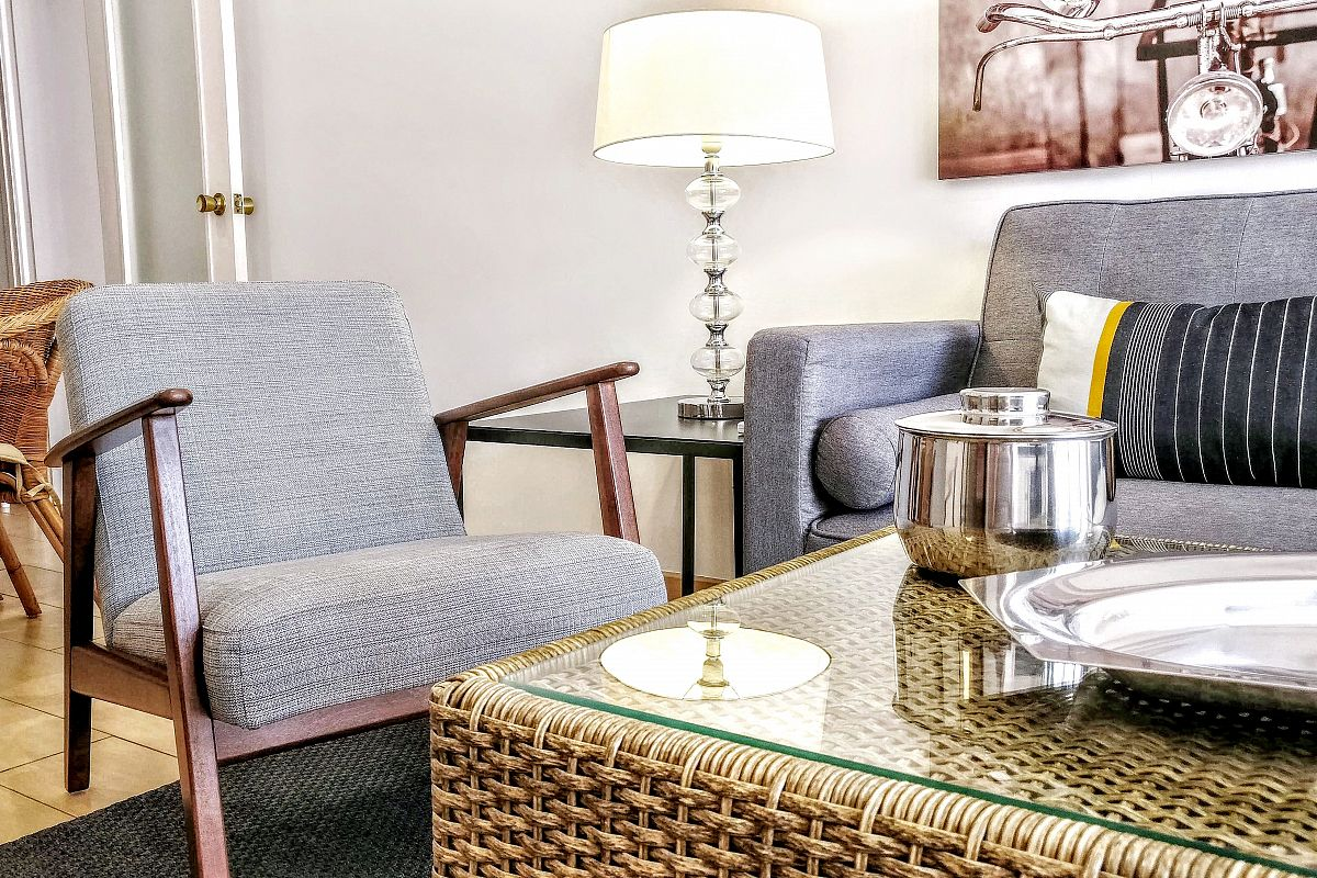 the living area with this comfortable pair of armchairs next to the sofa at the Garden House apartment is very convenient for family trips to Barcelona during your short term rental stay