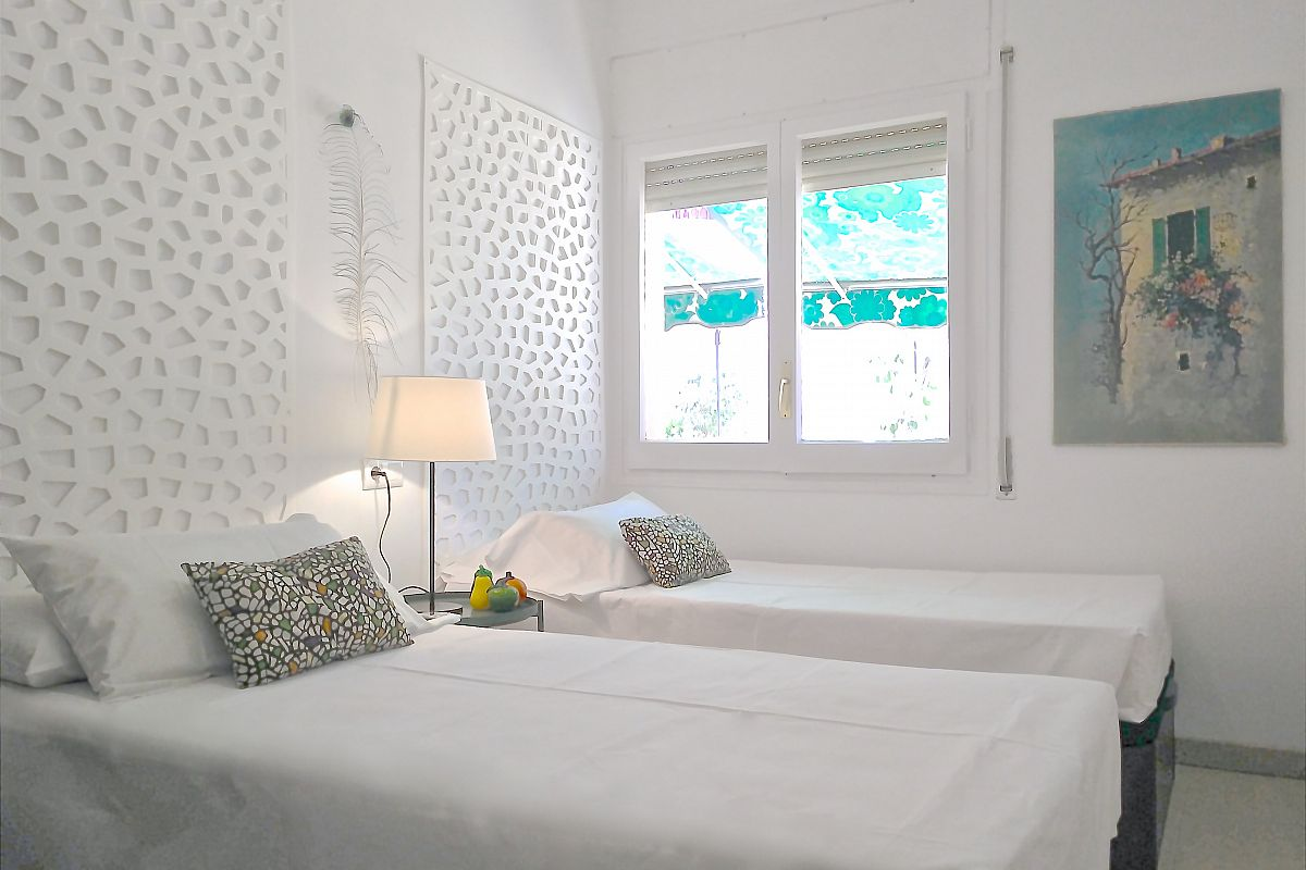 the second bedroom at the Garden House where all rooms face onto the terrace in this rental properties in Barcelona