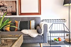 beautiful sofa corner with pictures composition, side tables and rattan table