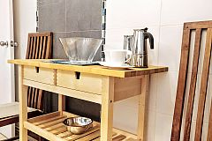 this convenient console table in the kitchen, according to your needs, may be a small occasional table or an auxiliar part of the kitchen countertop