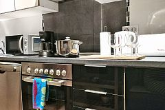 sleek cabinetry and stainless steel apliances are included in this fully equiped kitchen
