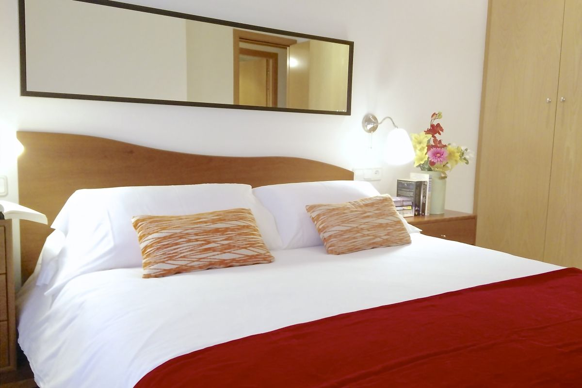 master bedroom at the Neo is one of the Barcelona apartments for rent short term for vacation getaways at bizflats.com