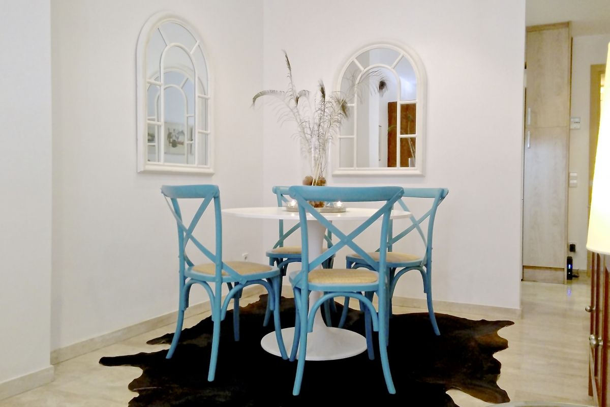 dining area dressed in blue in this Neo apartment family friendly 2BR and sunny Terrace in Eixample