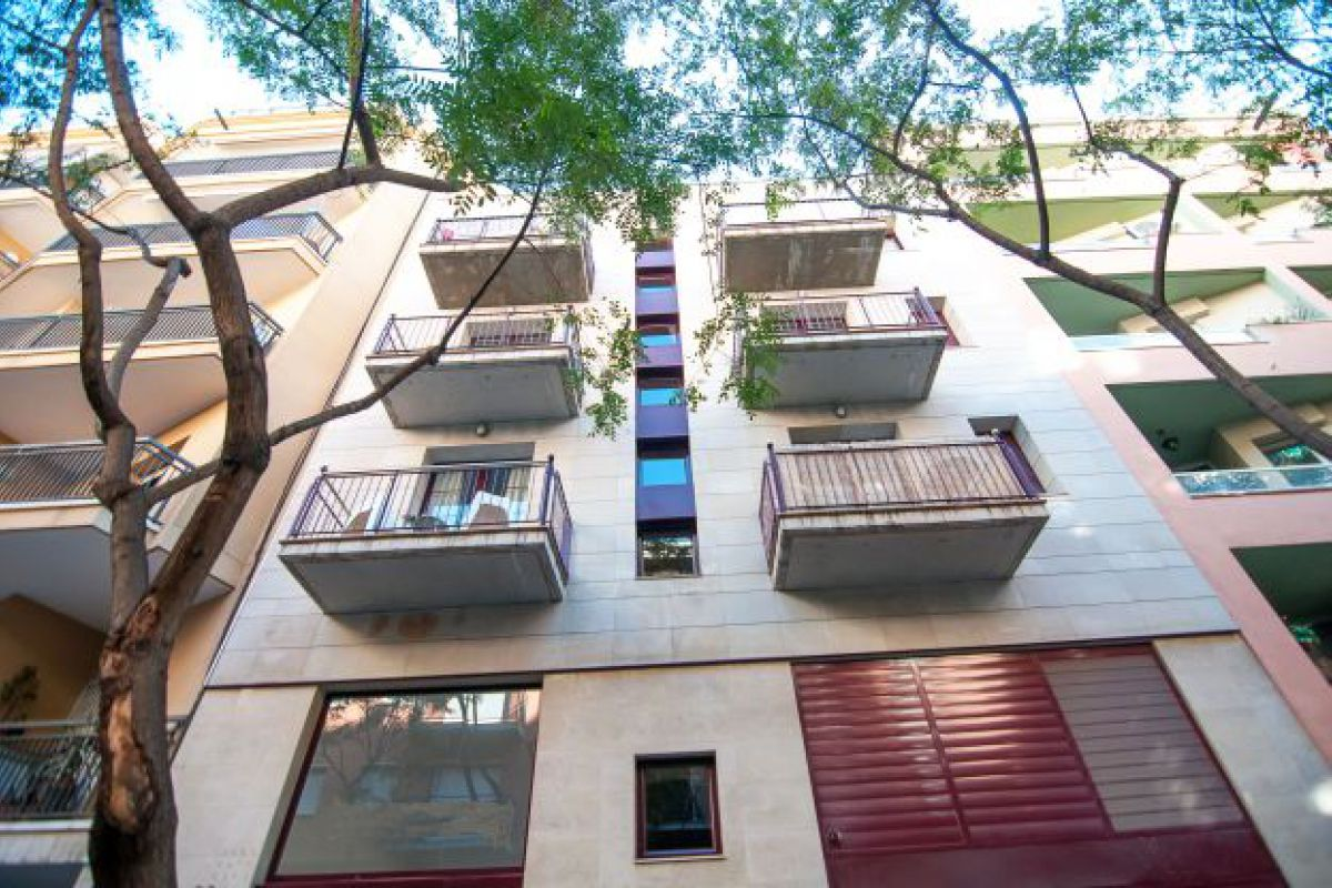 building façade of this apartment in Barcelona, located in the modernist Catalan neighbourhood of Eixample right distric