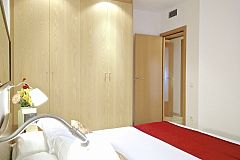 the master bedroom boasts a large closet for all the storage needs that you may need when visiting Barcelona