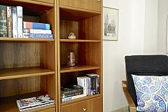 bookcase in the living area of the Neo apartment for rent short term in Barcelona