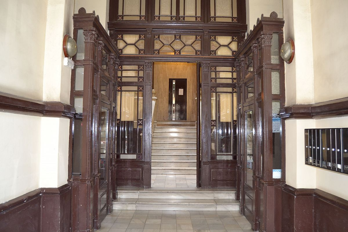 amazing luxurious wood and glass antique door in the inside foyer of the building