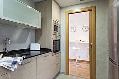 fully equipped modern kitchen with dishwasher, oven and microwave oven at LaMimosa apartment for rent short term in Barcelona