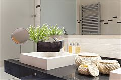 ensuite bath sink detail with sleek faucets