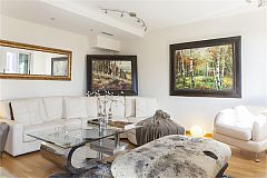 original pieces of furniture and oil paintings outstand in this lovely LaMimosa apartment in Eixample Barcelona