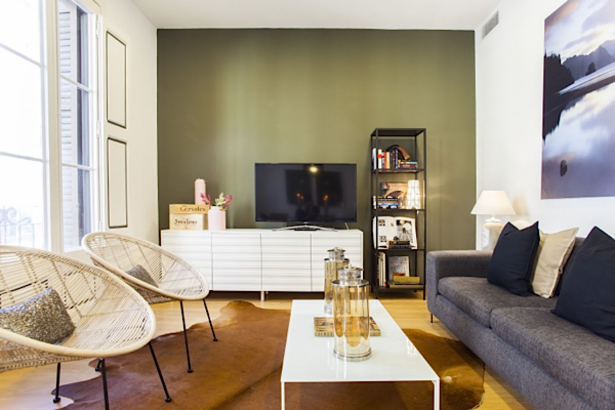 living room with pieces of furniture by Pilma in this luxury short term apartment rentals in Barcelona