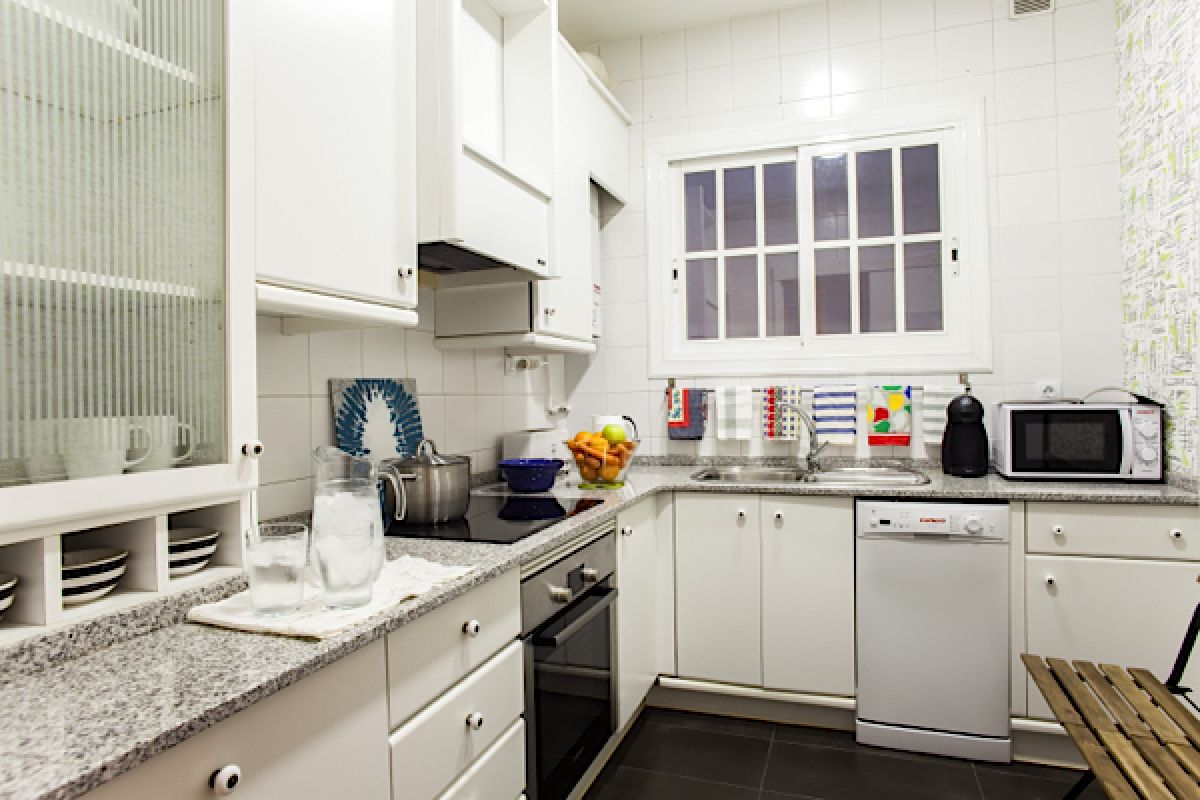 fully equipped black and white kitchen with washer and dishwasher