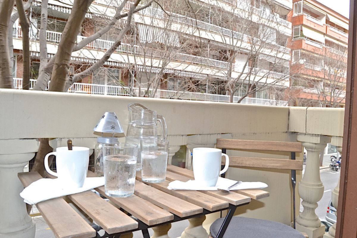 enjoy a cup of coffee in the balcony of the KissMe apartment central location furnished apartment