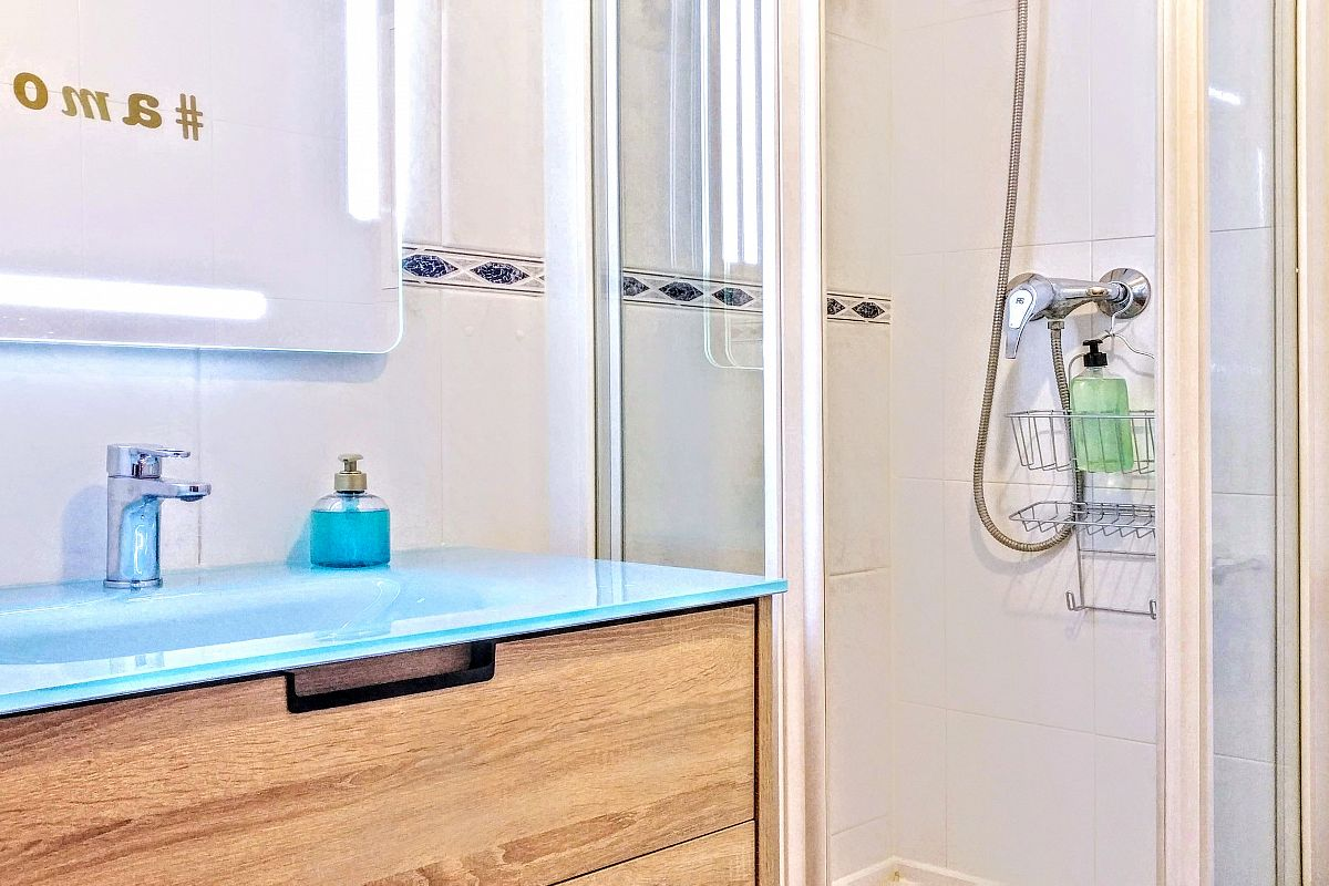 blue sink next to the shower