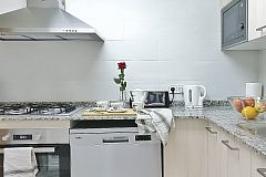 the Kitchen, a clean, fully fitted kitchen with all utensils, dishwasher and washer