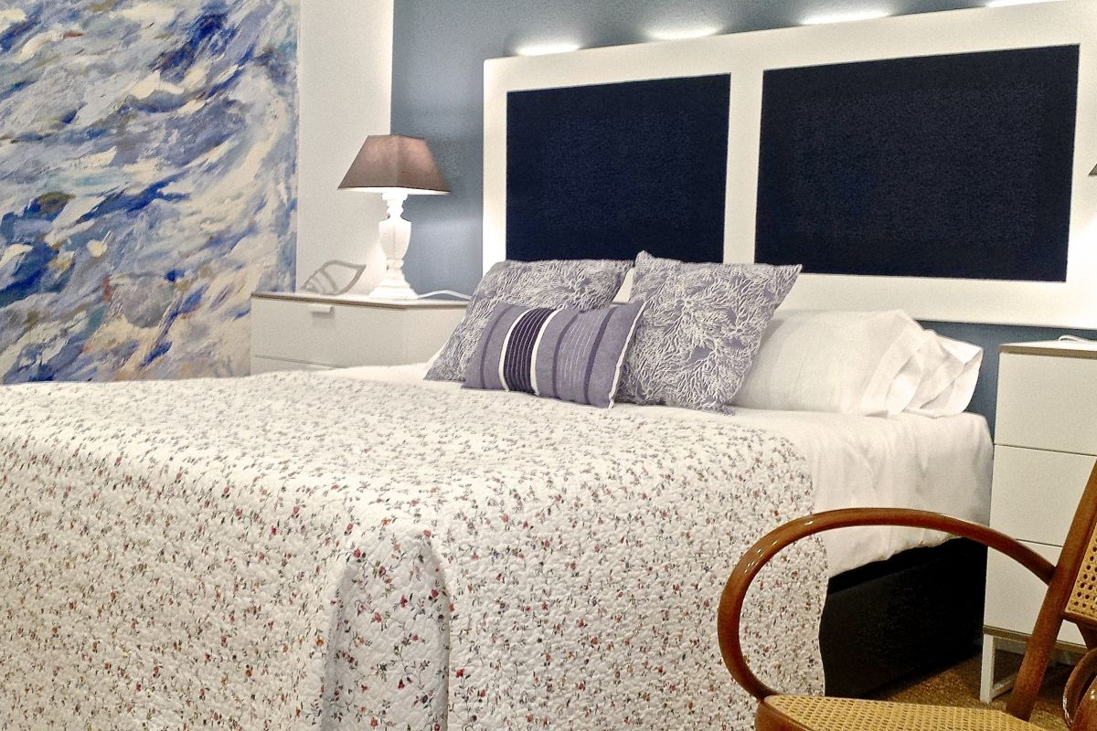 detail of the beautiful and original white and blue headboard with design lighting with leds