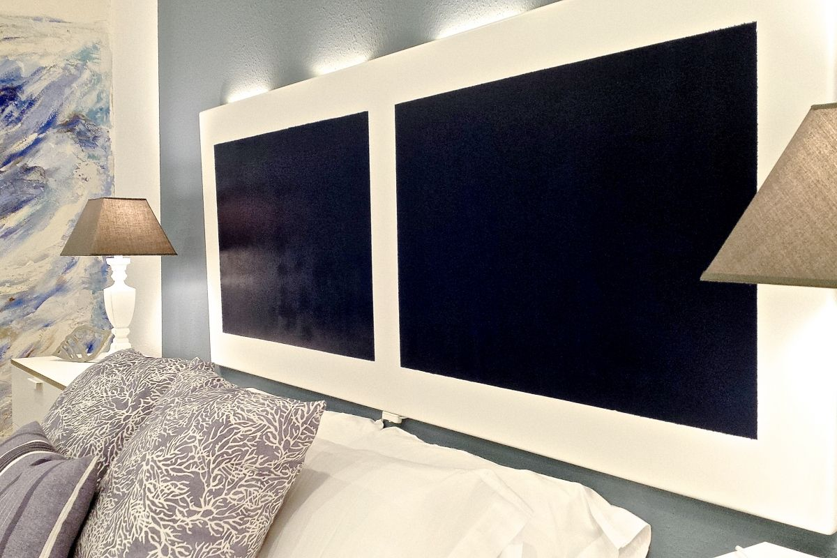 lovely headboard detail with designer lighting touches