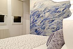 dramatic wall painted in shades of blue, memories of the Mediterranean sea present in the beaches of Barcelona