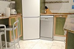 fully equipped kitchen with washer and dishwasher