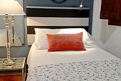 Macca flat for rent for months in Barcelona third bedroom with a dramatic big size bedside lamp