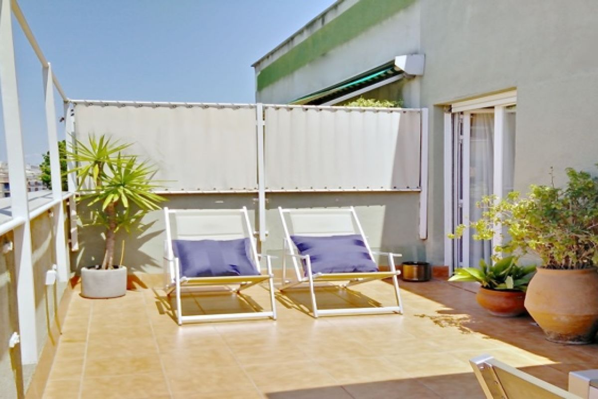 terrace of THE PENTHOUSE apartment with 2 bedrooms in Eixample close to Camp Nou in Barcelona