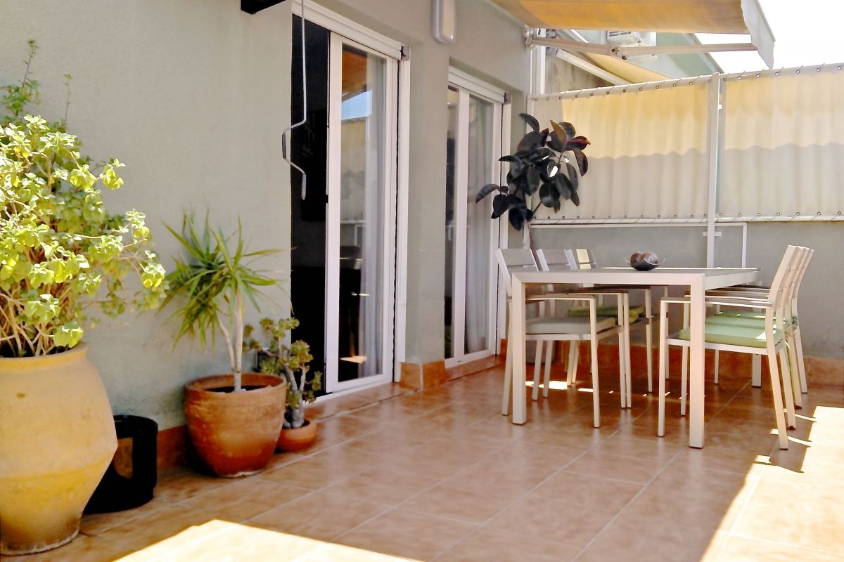 outdoors dining area at the Penthouse apartment with Terrace in Eixample Barcelona close to Sants station