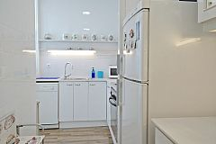 kitchen in this The Penthouse apartment with sunny Terrace for rent in Barcelona Eixample for monthly rentals