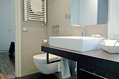 the main bathroom boasts a heated towel rail and hair dryer