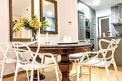 the dining area, is a winning mixture of styles at Parsifal La Rambla 3 bedroom monthly rental