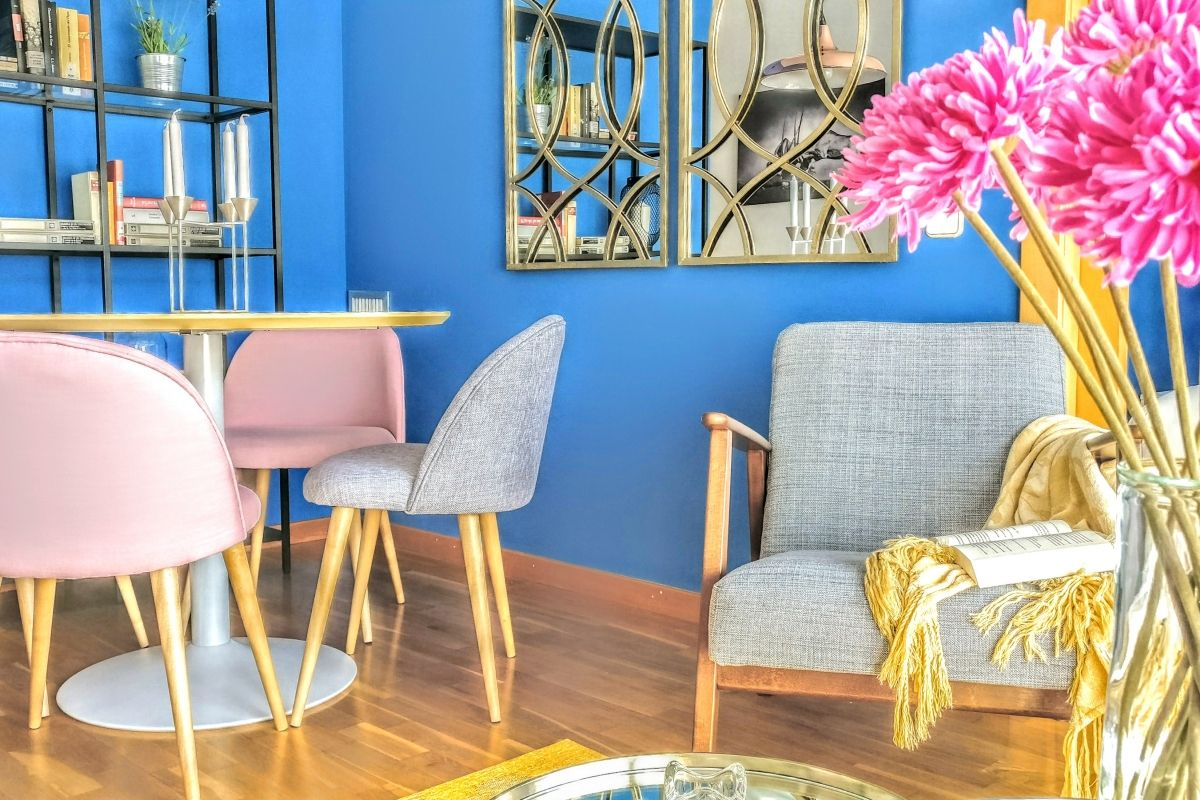 dining area and grey armchair at the Dandelion apartment for rent for long stays in Barcelona with terrace by L'illa Diagonal shopping mall