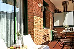 furnished terrace with a view to the city in this Dandelion apartment with terrace in Barcelona for monthly stays