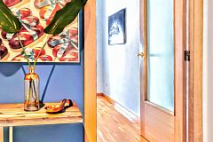 entrance with sleek design and painted in blue at the Dandelion apartment for rent for months in Barcelona with Terrace Luxury close to Diagonal Avenue