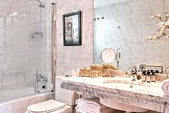 master ensuite bathroom in white marble with bathtub