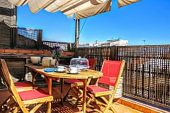 outdoors dining area at the Jollie penthouse apartment with Terrace in Les Corts Barcelona