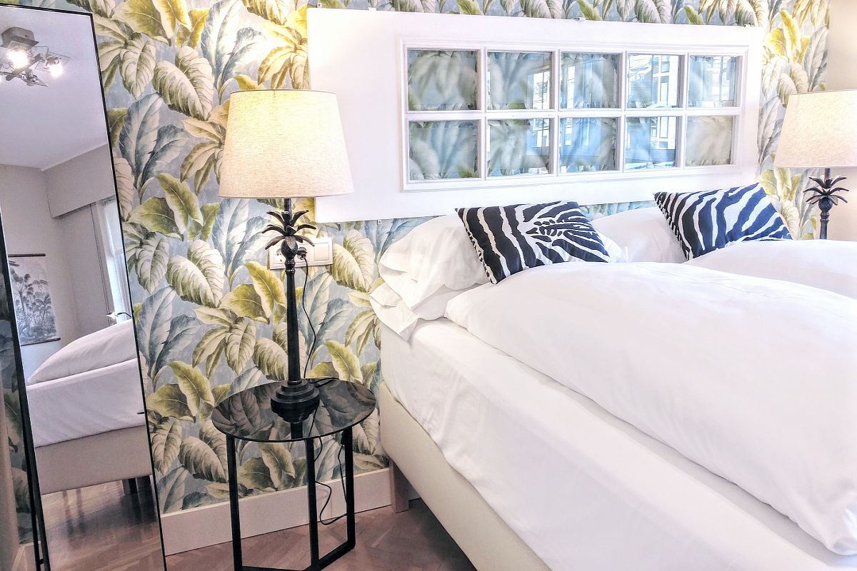 in this double bedroom of the Gatsby vacation rental in Barcelona the power of zebras and green leaves will elevate your spirit