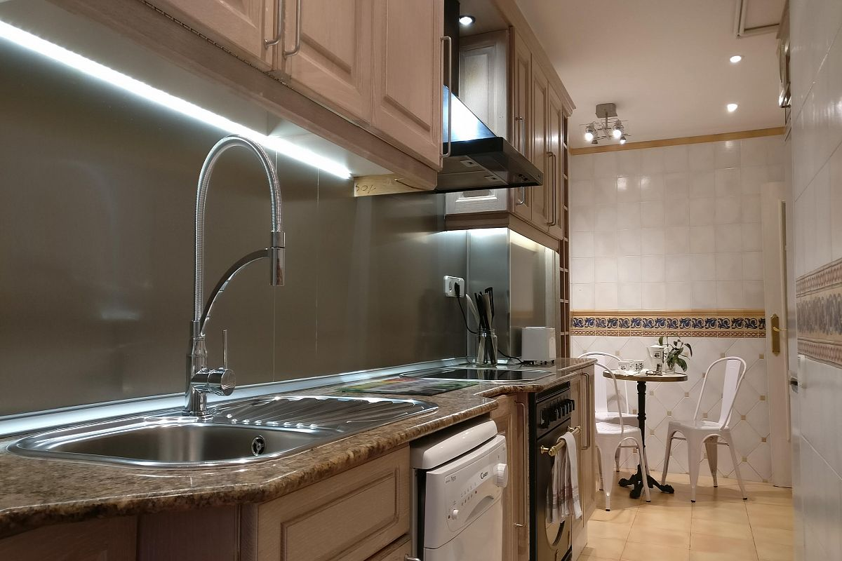 LED strips under the cabinets in the private kitchen at ahe Gatsby  apartment in Les Corts with terrace near Diagonal avenue